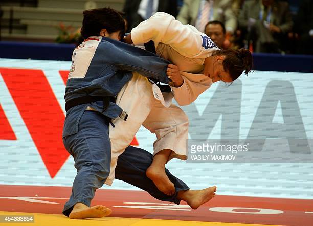 Slovenia's judoka Anamari Velensek competes with North Korea's Kyong Sol during the under 78 kg competition for bronze medal at the IJF World Judo...