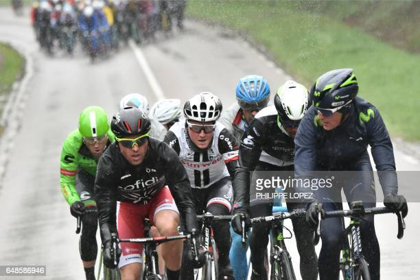 TOPSHOT Slovenia's Kristjan Koren France's Julien Simon Netherlands' Sam Oomen Eritrea's Natnael Berhane and Spain's Marc Soler ride in a breakaway...
