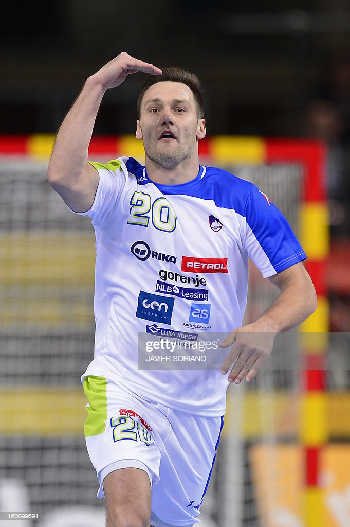 Slovenia's left wing Luka Zvizej celebrates after scoring during the 23rd Men's Handball World Championships bronze medal match Slovenia vs Croatia at the Palau Sant Jordi in Barcelona on January 26, 2013. AFP PHOTO/ JAVIER SORIANO