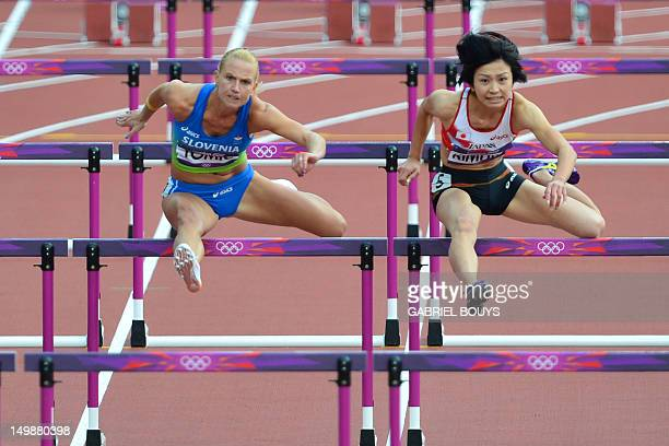 Slovenia's Marina Tomic and Japan's Ayako Kimura compete in the women's 100m hurdles heats at the athletics event of the London 2012 Olympic Games on...
