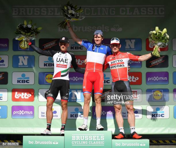 Slovenia's Marko Kump of UAE Team France's Arnaud Demare of FDJ and Germany's Andre Greipel of Lotto Soudal celebrate on the podium after the 5th...