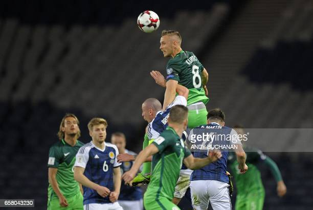 Slovenia's midfielder Jasmin Kurtic wins a header during the World Cup 2018 qualification football match between Scotland and Slovenia at Hampden...