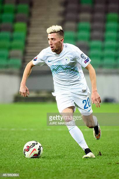 Slovenia's midfielder Kevin Kampl controls the ball during the Euro 2016 qualifying group E football match between Slovenia and San Marino at the...
