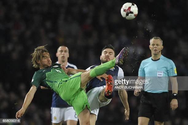 Slovenia's midfielder Rene Krhin vies with Scotland's forward Robert Snodgrass during the World Cup 2018 qualification football match between...