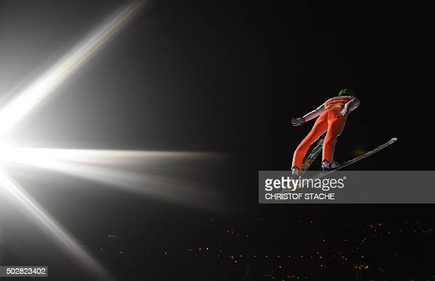 Slovenia's Peter Prevc soars through the air during the first competition jump of the ski jumping event in Oberstdorf southern Germany which is the...