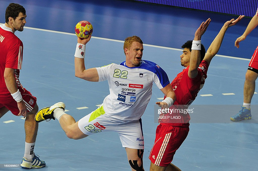 Slovenia's pivot Matej Gaber (L) shoots past Croatia's right back Luka Stepancic during the 23rd Men's Handball World Championships bronze medal match Slovenia vs Croatia at the Palau Sant Jordi in Barcelona on January 26, 2013. AFP PHOTO/ JOSEP LAGO