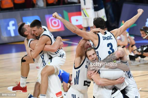 Slovenia's players celebrate after defeating Serbia during the FIBA Eurobasket 2017 men's Final basketball match between Slovenia and Serbia at Sinan...