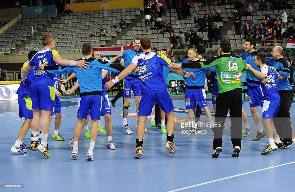 Slovenia's players celebrate their victory at the end of the 23rd Men's Handball World Championships round of 16 match Slovenia vs Egypt at the Palau Sant Jordi in Barcelona on January 21, 2013.