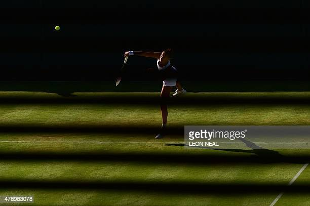 Slovenia's Polona Hercog serves against US player Lauren Davis during their women's singles first round match on day one of the 2015 Wimbledon...