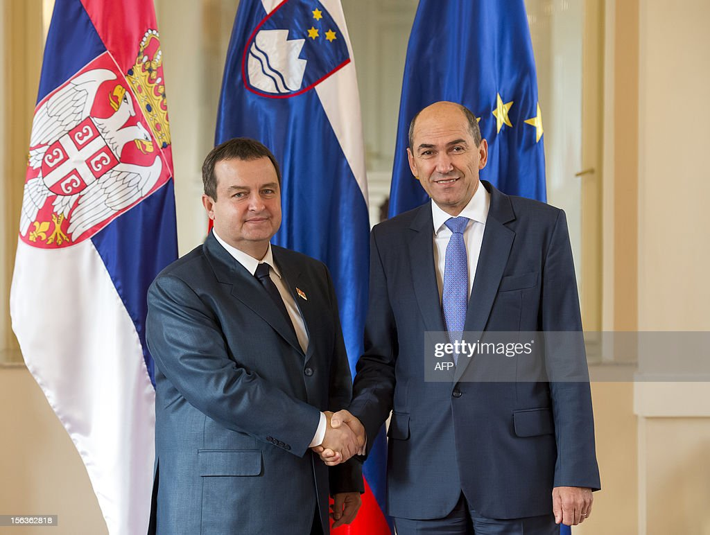 Slovenia's Prime Minister Janez Jansa (R) shakes hand with his Serbian counterpart Ivica Dacic before a meeting in Ljubljana on November 14, 2012.