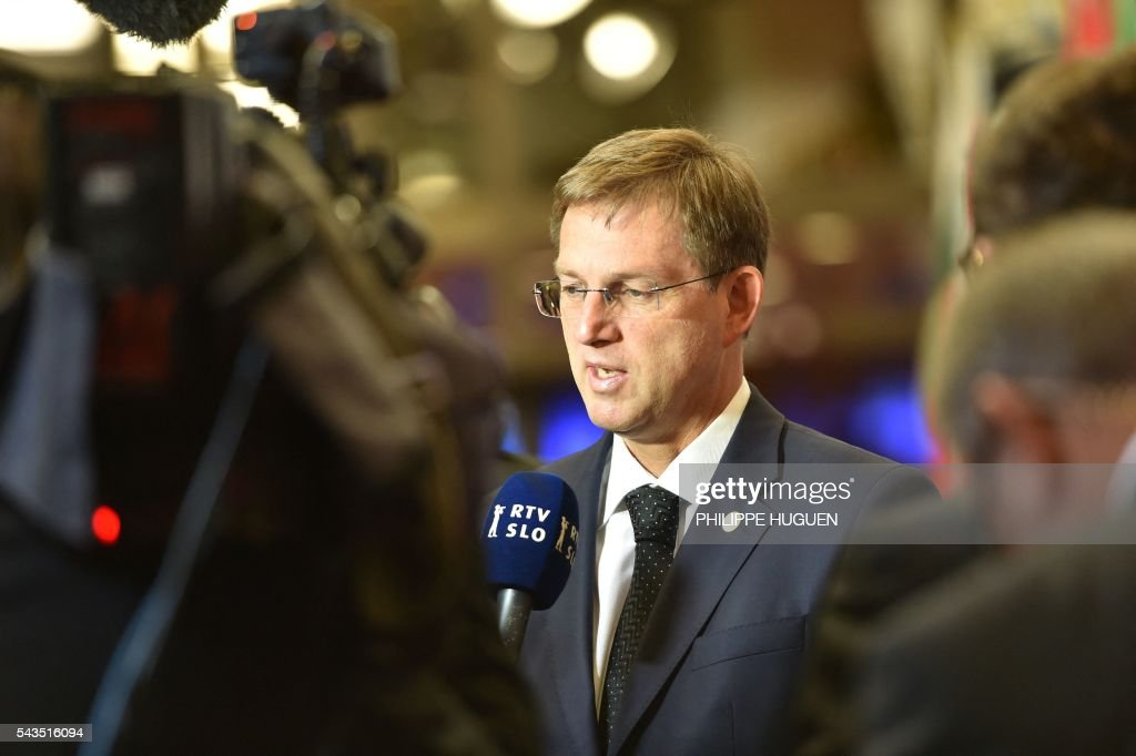 Slovenia's Prime minister Miro Cerar addresses the media as he arrives for the second day of an EU - Summit at the EU headquarters in Brussels on June 29, 2016. European Union leaders will on June 29, 2016 assess the damage from Britain's decision to leave the bloc and try to prevent further disintegration, as they meet for the first time without a British representative. / AFP / PHILIPPE