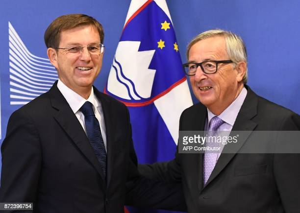 Slovenia's Prime Minister Miro Cerar is welcomed by European Commission President JeanClaude Juncker at the European Commission in Brussels on...