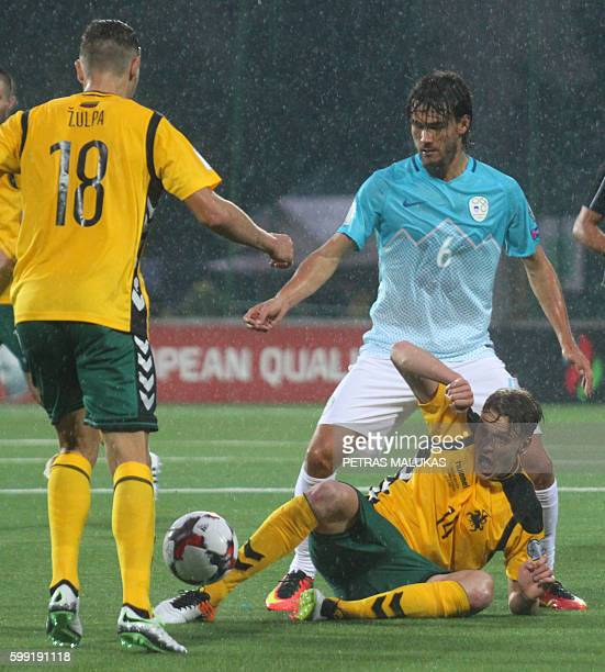 Slovenia's Rene Krhin vies with Lithuania's Arturas Zulpa and Vykintas Slivka during the World Cup 2018 football qualification match between...