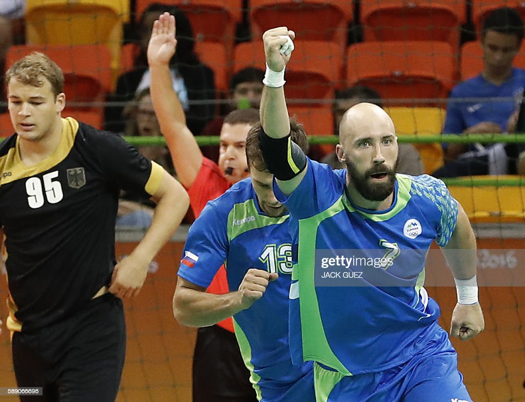 Slovenia's right back Vid Kavticnik celebrates a goal during the men's preliminaries Group B handball match Slovenia vs Germany for the Rio 2016...