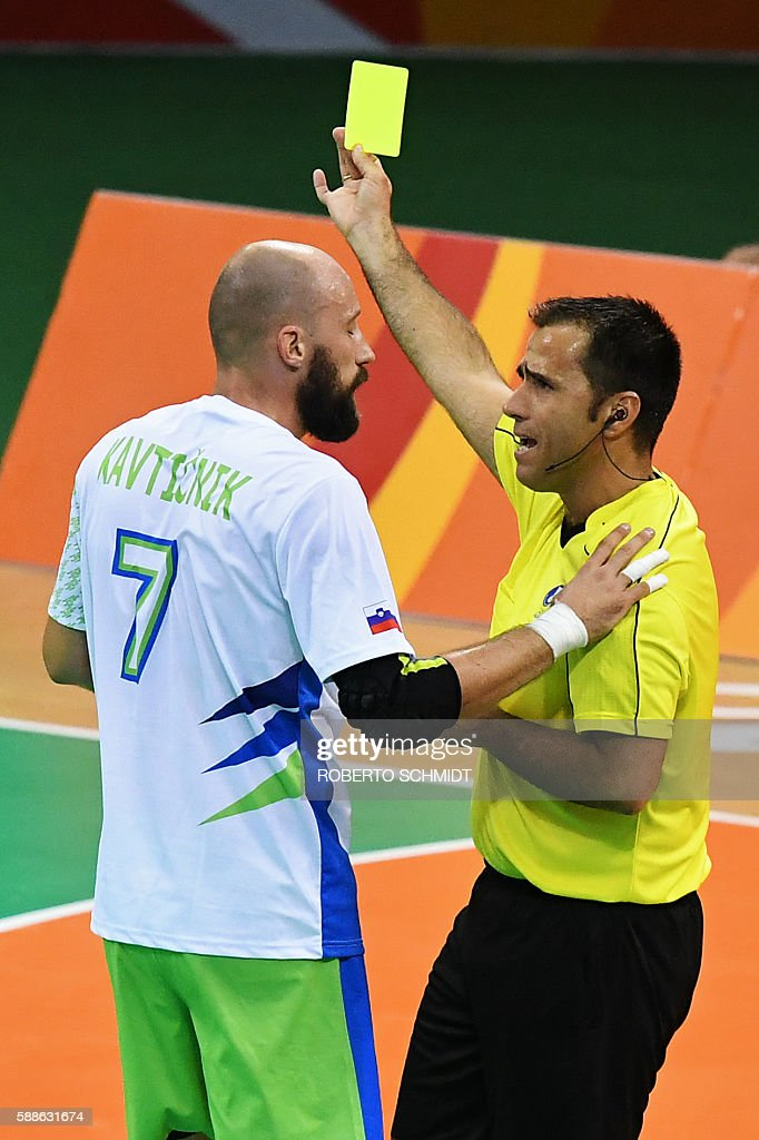 Slovenia's right back Vid Kavticnik is shown a yellow card during the men's preliminaries Group B handball match Slovenia vs Sweden for the Rio 2016...
