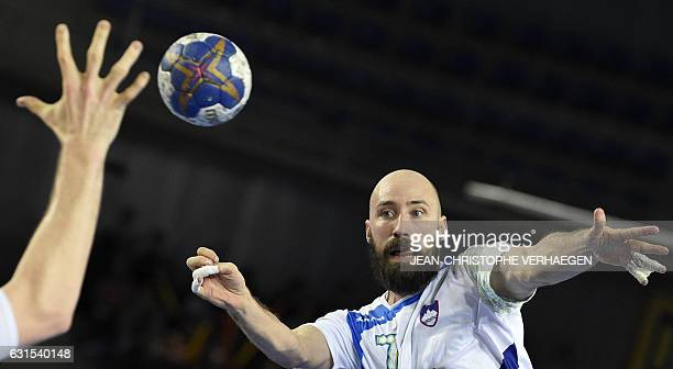 Slovenia's right back Vid Kavticnik passes the ball during the 25th IHF Men's World Championship 2017 Group B handball match Slovenia vs Angola on...