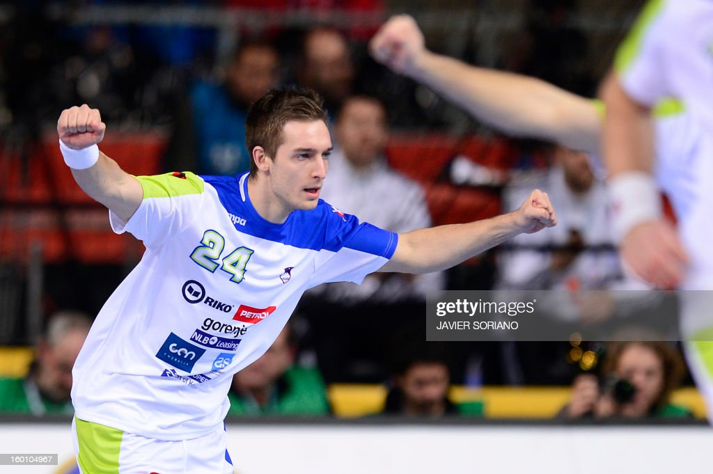 Slovenia's right wing Gasper Marguc celebrates after scoring during the 23rd Men's Handball World Championships bronze medal match Slovenia vs Croatia at the Palau Sant Jordi in Barcelona on January 26, 2013.