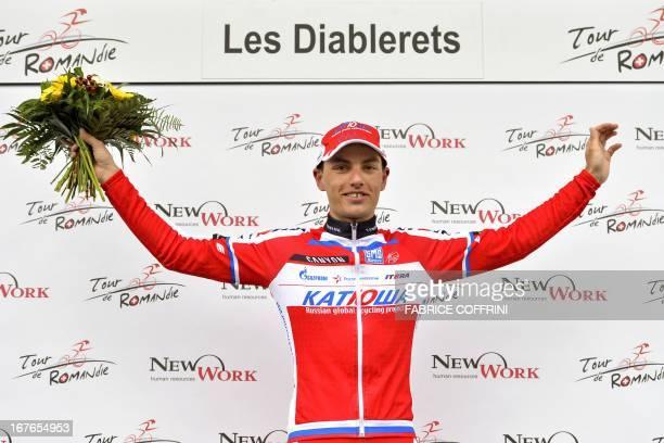 Slovenia's Simon Spilak celebrates after winning the fourth stage of the Tour de Romandie cycling race on April 27 2013 in Les Diablerets Briton...