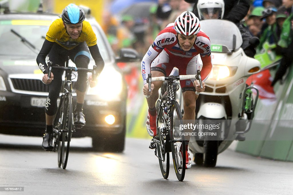 Slovenia's Simon Spilak (R) races the finish line to win the fourth stage of the Tour de Romandie cycling race, ahead of the overall leader Christopher Froome of Britain (L), on April 27, 2013 in Les Diablerets. Briton Froome tightened his grip on the yellow jersey as he finished just behind Spilak after 188.5km from Marly to Les Diablerets.
