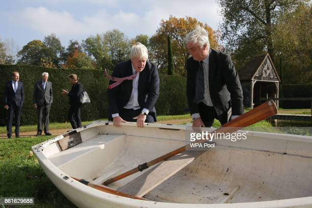 Slovenia's State Secretary at the Ministry of Foreign Affairs Andrej Logar helps Britain's Foreign Secretary Boris Johnson manoeuvre during a visit...