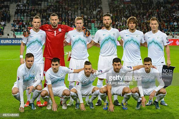 Slovenia's teammates Jasmin Kurtic Samir Handanovic Robert Beric Bostjan Cesar Rene Krhin Valter Birsa and Josip Ilicic Branko Ilic Dejan Lazarevic...