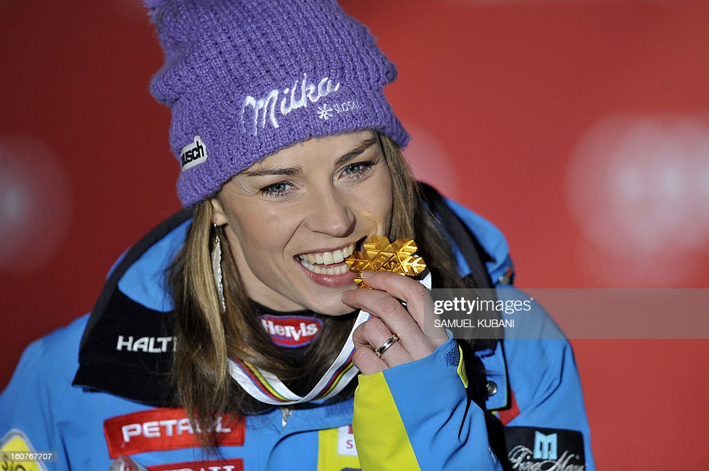 Slovenia's Tina Maze bites her gold medal after winning the women's Super-G event of the 2013 Ski World Championships in Schladming, Austria on February 5, 2013.