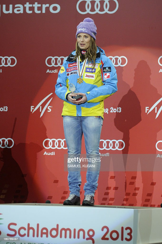 Slovenia's Tina Maze celebrates on the podium after winning the women's Super-G event of the 2013 Ski World Championships in Schladming, Austria on February 5, 2013