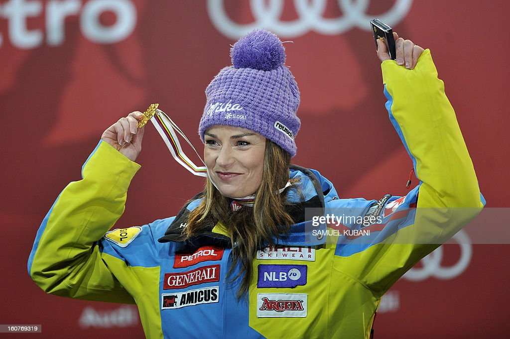 Slovenia's Tina Maze celebrates with her gold medal after winning the women's Super-G event of the 2013 Ski World Championships in Schladming, Austria on February 5, 2013.