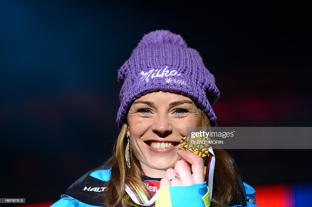 Slovenia's Tina Maze holds her gold medal after winning the women's Super-G event of the 2013 Ski World Championships in Schladming, Austria on February 5, 2013. MORIN