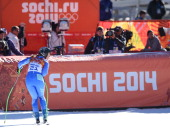 Slovenia's Tina Maze reacts after taking equal first place in the Women's Alpine Skiing Downhill at the Rosa Khutor Alpine Center during the Sochi...