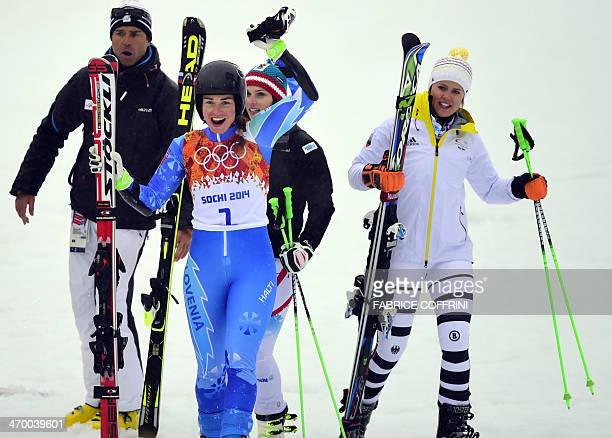 Slovenia's Tina Maze reacts in the finish area next to Germany's Viktoria Rebensburg and Austria's Anna Fenninger during the Women's Alpine Skiing...