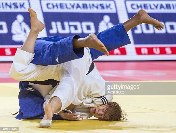 Slovenias Tina Trstenjak competes with Frances Clarisse Agbegnenou during the womens gold medal match in the 63kg category at the Judo World...