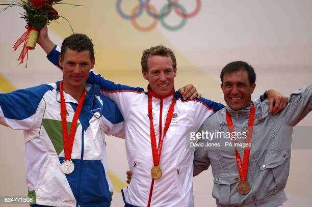 Slovenia's Vasilij Zbogar with his silver medal Great Britain's Paul Goodison with gold and Italy's Diego Romero with bronze during the medal...