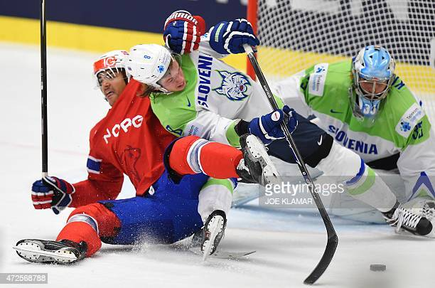 Slovenia's Ziga Jeglic takes Norway's Andreas Martinsen during the group B preliminary round match between Slovenia and Norway during the IIHF Ice...