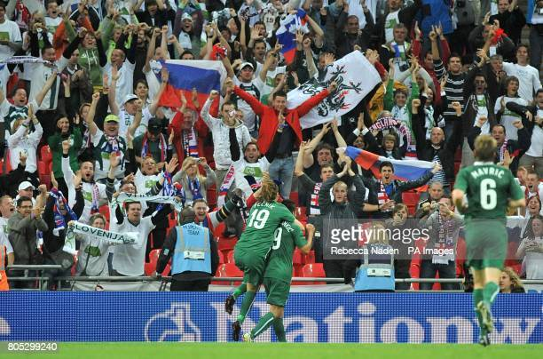Slovenia's Zlatan Ljubijankic celebrates scoring in front of the Slovenian fans