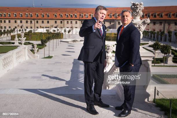 Slovkia's Prime Minister Robert Fico welcomes Hungarian Prime Minister Viktor Orban as he arrives at Bratislava Castle for a Summit on Equal Quality...
