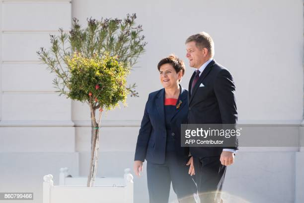 Slovkia's Prime Minister Robert Fico welcomes Polish Prime Minister Beata Szydlo as she arrives at Bratislava Castle for a Summit on Equal Quality of...