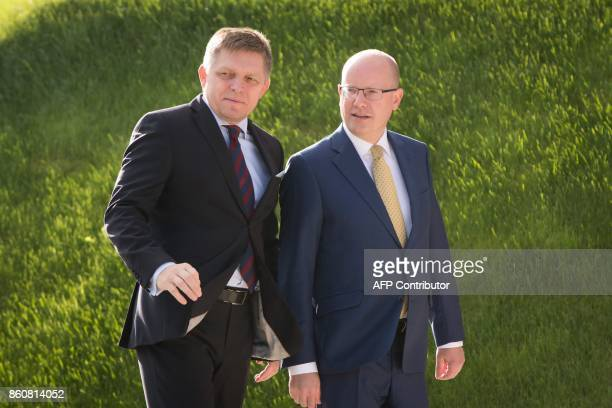 Slovkia's Prime Minister Robert Fico welcomes the Prime Minister of the Czech Republic Bohuslav Sobotka as he arrives at Bratislava Castle for a...