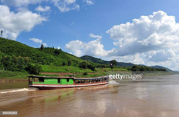 A 'slow' boat cruises on the Mekong river on October 15 2009 near the ThaiLao border town of Huay Xay in northern Laos Trips on slow boats from the...