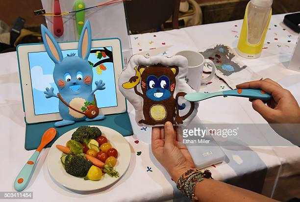 Slow Control's Yum Done the first smart spoon and a cuddly toy to help make kids eat their vegetables is displayed during a press event for CES 2016...