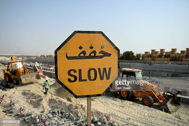 A slow sign is pictured at construction site on September 14 2016 in Dubai United Arab Emirates