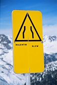 Slow sign on snowy mountain (selective focus)
