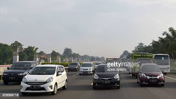 Slow traffic is seen on a highway as a long weekend begins in Jakarta on May 5 2016 Indonesians are enjoying two consecutive religious holidays the...