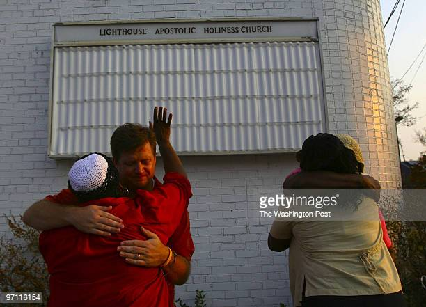 Mississippi Katrina Date Credit Michel duCille/TWP 709 Division Street Biloxi Miss Hurricane Katrina Jeff Cassidy hugs Brenda Boykin while Rosie...