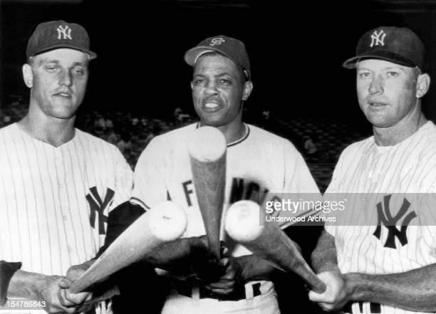 Slugging outfielders before an exhibition game at Yankee Stadium LR Roger Maris Yankees Willie Mays Giants and Mickey Mantle Yankees New York New...