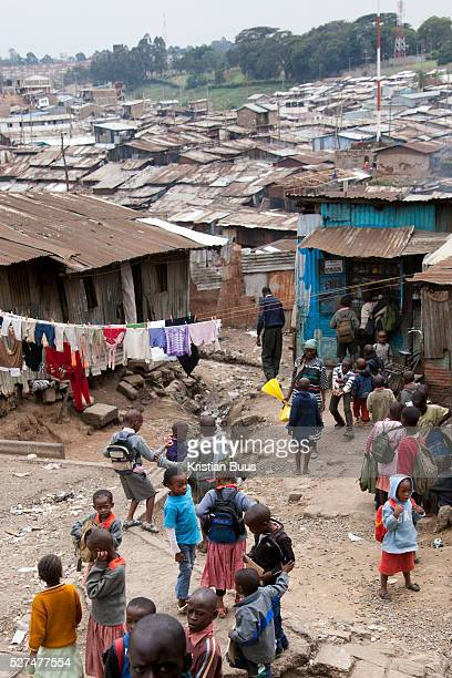 A slum in Nairobi School is over for the day and the come out to head home through the myriade of shacks Nairobits a charity teaching kids from...