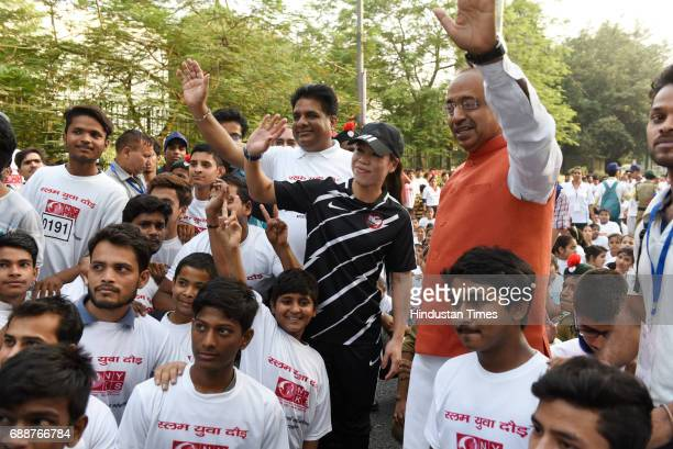 Slum Youth Run was organized by Ministry of Sports and was flagged off by Minister of State for youth affairs and Sports Vijay Goel Olympic Indian...