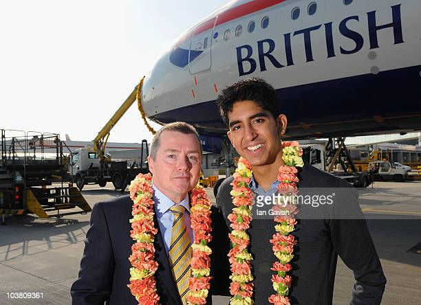 Slumdog Millionaire actor Dev Patel and BA Chief Executive Willie Walsh pose by the new British Airways Boeing 777 300ER on its inaugural flight to...