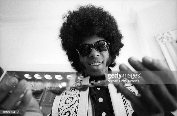 Sly Stone of the psychedelic soul group 'Sly And The Family Stone' tries on a necklace on March 9 1969