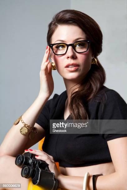 Sly woman holding binoculars
